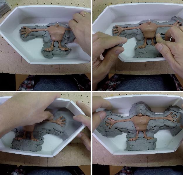 Préparation d'un lit d'argile pour fabriquer un personnage d'animation en stopmotion